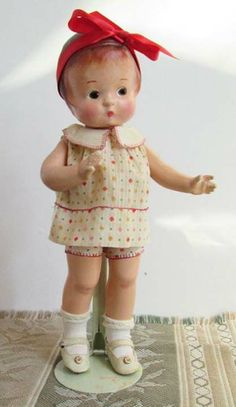 """My very first find of a left-glancing Patsy. Left-glancing Patsy dolls are unusual. They are not a factory mistake, these dolls were hand painted. They simply didn't make very many of them. She is wearing her original dress and """"onesie"""", original socks with a decorative top and original leather side strap shoes."""