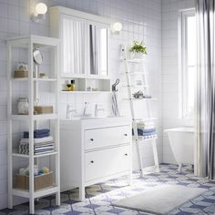 A white bathroom with HEMNES washstand, shelf, and mirror cabinet in white plus a blue shower curtain and blue and white towel from IKEA White Bathroom, Small Bathroom, Budget Bathroom, Bathroom Shelves, Bathroom Remodeling, Bathroom Ideas, Bathroom Colors, Bathroom Organization, Bathroom Faucets