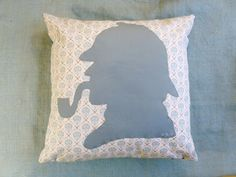 The perfect pillow choice for your cozy book chair or corner! Machine appliqued silhouette of the famous Sherlock Holmes on the front of a comfy throw pillow. Pillow measures 16″ x 16″.  Li…