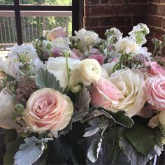 Centerpieces with rose, ranunculus, and dusty Miller