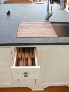 I'm totally going to make a cutting board that fits into our drop sink