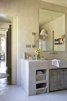 Love the built-in stone sink/storage unit. And the simple mirror. Not too keen on all the decorative accents.
