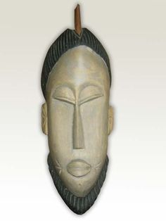 Hand carved, traditional hardwood mask depicting a male with beard and traditional hair do.