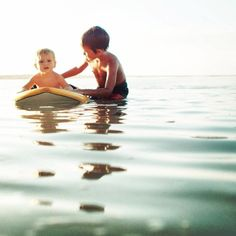 This is around the exact age that my son Mason learned how to surf.(>: He could surf before he could swim. Funny huh?