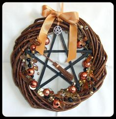 A beautiful hand decorated Yule wreath...... The wooden Wreath itself is 8 (20cms) diameter. In the center is a Bog Oak Pentagram 5 (13cms)