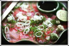 Tuna sashimi. Tuna - wasabi - lemon - ginger - kikoman sauce with leek onion garnish.  60 K