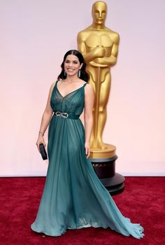 America Ferrera wearing a sea green chiffon number by Duchess of Cambridge favourite Jenny Packham that is lovely now but looks as though there could be underslip issues later in the night. Let's hope not.