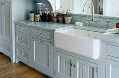 I wish for a farmhouse sink.  I love this arrangement, but would not do blue cabinets.