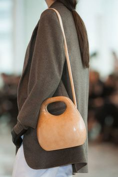 Christophe Lemaire Fall 2014, so cool #leatherbag