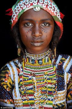 Up close and personal with amazing portraits of African tribespeople: This girl is from Niger and is a member of the Hausafulani people