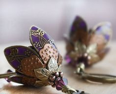 Hey, I found this really awesome Etsy listing at http://www.etsy.com/listing/157138405/flower-dangle-earrings-purple-romantic