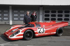 Hans Herrmann (left) and Richard Attwood (right) on their winner car Porsche 917 KH Coupé #23
