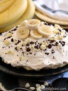 White Chocolate Banana Cream Pie - One of the best pies I've ever had! Layer upon layer of dark chocolate crumbs, banana slices, white chocolate custard and whipped cream make this one AMAZING pie recipe!