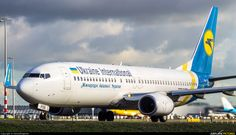 High quality photo of Ukraine International Airlines Boeing 737-800 by DennyRingenier. Visit Airplane-Pictures.net for creative aviation photography.