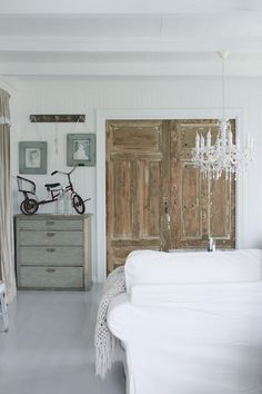 Something about this room just looks cool! Don't know about the bicycle in the dresser though...