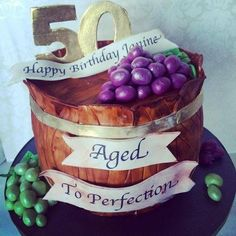 I made this wine barrel cake for a special lady turning 50. The grapes are made with modeling chocolate, I wanted them to be yummy.