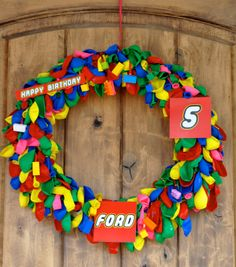 Incredible LEGO birthday party.  LEGO decorations - front door wreath with balloons and legos hanging from it!