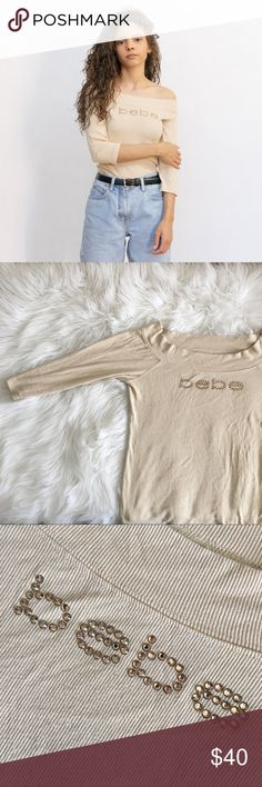 "Tan Bebe off the shoulder top 🍊✨ Tan Bebe off the shoulder top 🍊✨ what a gem! This piece has taupe colored rhinestones that spell out ""Bebe"", it's also ribbed. Looks super cute tucked into a pair of mom jeans! 🌷💕 size small (can fit size medium) , 10/10 condition bebe Tops"