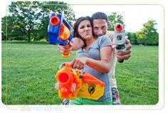 A cute couple posing with their nerf guns.