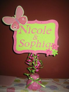 name sign for the presents table at a duel baby shower