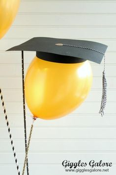 Surprise your graduate with a fun DIY Graduation Cap Balloon Gift or use these fun balloons for centerpieces at your graduation party.