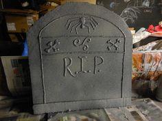 DIY Tombstones for Halloween.  Styrofoam, hot glue gun, and spray paint.
