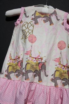 Elephant dress by craft room. Makes me want a little girl so I can have my mom make her something like this lovely dress.