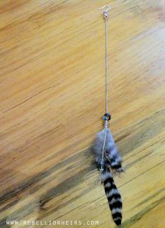 FREE SHIPPING Cryptical Envelopment - A Single Bohemian Luxe Inspired Feather Shoulder Duster w Reclaimed Crystal... by rebellionheir((s)). $20.00, via Etsy.
