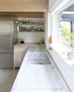 Check out this monumental marble moment. How beautiful is this weighty  marble counter and open storage combo? Design and  @scottandscottca