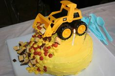 First birthday cake for boy. CAT truck. Banana cake.