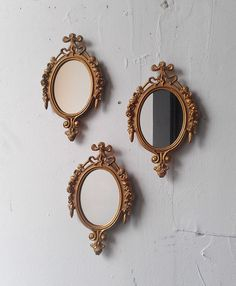 Gold Mirror Set, Small Decorative Vintage Frames, Mid Century Modern Wall Decor, Wall Collage, Vintage Oval Mirrors, Hollywood Regency by SecretWindowMirrors on Etsy https://www.etsy.com/listing/219086393/gold-mirror-set-small-decorative-vintage