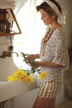.Love everything about this photo.  The scarf, the sweater, the shorts, the necklace, the vintage kitchen sink, and of course, fresh yellow flowers.