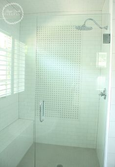 Master Bathroom Shower with White Subway Tile and Rainhead