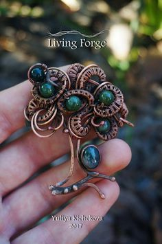 The brooch made from copper with agate cabochons agate ebusine. Brooch made in the technique of wire wrap. Main material patinated copper, Caramon agate, agate beads. The length of the brooch is 2.36 inches (6 cm), Width 1.97 inches (5 cm). Brooch with a protective coating that will