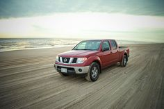 Riding the tide with four wheel drive, Nathan M.'s Nissan Frontier is ready for all the sandy action it can get. Look out, beach bums!