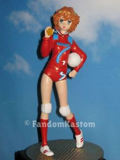 """MILA HAZUKI from """"Mila Shiro, two hearts in volleyball - Attacker You !!"""" - Height 18 cm. The model, made entirely of resin, and all its accessories have been created, molded, sculpted and assembled exclusively by FandomKastom. Azuki Mila is represented here in the uniform of the """"Seven Fighters"""". Also ordered the version with the first white uniform when Mila start playing volleyball in the """"Hikawa"""" mythical school team. AVAILABLE"""