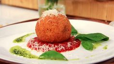 Daniel Mezzolo's Arancini - Arancini or arancine are fried rice balls coated with breadcrumbs, said to have originated in Sicily in the 10th century.