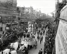 "Feb. 27, 1900. ""Mardi Gras procession on Canal Street, New Orleans."""