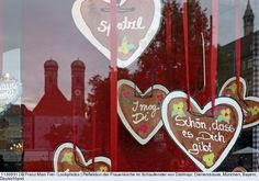 Reflection of Frauenkirche in the shop window of Dallmayr, Dienerstrasse, Munich, Bavaria, Germany