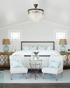 Feminine beach house style bedroom in white with sea colors in details