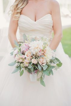 Romantic Rose, Peony and Eucalyptus Bouquet - by Buttercup.  https://www.theknot.com/real-weddings/a-colorful-vintage-inspired-wedding-at-the-john-james-audubon-center-in-audubon-pennsylvania-album