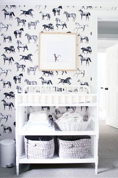 animal obsession - loving the repetitive black + white horse wallpaper with the added touch of the lone monkey art
