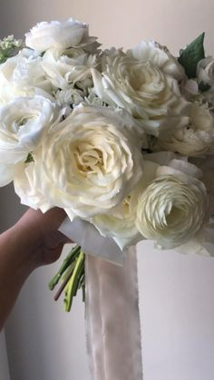 This classic & dreamy all white wedding bouquet is layered with fluffy goodness and includes peonies, Alabaster garden roses, ranunculus, bouvardia and phlox! #whiteweddingflowers #alabastergardenroses #champagnesilkribbon #bouquetwithtrailingribbon #calgary #calgaryweddings #calgaryflorist #whiteweddingbouquet #whitepeonies #peonybouquet #whitebridalbouquet All White Wedding, White Wedding Bouquets, Bridesmaid Bouquet, Bridal Bouquets, Floral Wedding, Summer Wedding, Flower Girl Bouquet, Peonies Bouquet, Ranunculus