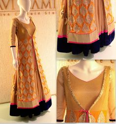 Floor length Anarkali in gold textured fabric with bold velvet border paired with a long side-slit embroidered jacket.