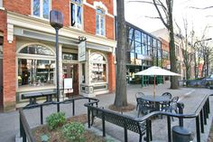 GREENVILLE, SC - DOWNTOWN: popular, charming, award winning historic area. Store front view along Main Street, Greenville, SC