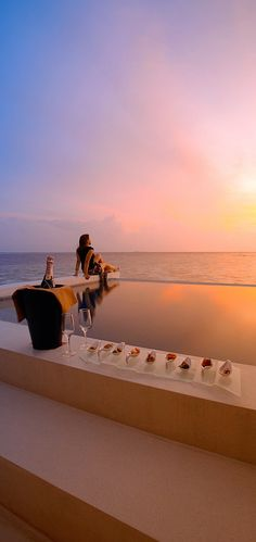 zen time, zen tranquility, how relaxing at the sunset lit edge pool; Lily Beach, Maldives
