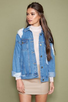 A midweight denim jacket featuring a distressed look, basic collar, flap chest pockets, slanted front pockets, and a buttoned front.