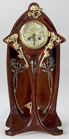A French Art Nouveau mahogany clock by Georges Ernest Nowak with elaborate bronze, pewter and mother-of-pearl decoration in floral and vegetal motifs. Old Clocks, Antique Clocks, Mantel Clocks, Vintage Clocks, Antique Watches, Antique Art, Jugendstil Design, Art Nouveau Furniture, Art Nouveau Design