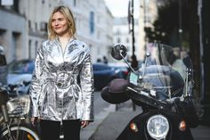 We're into any multi-functional piece, like this silver coat that easily doubles as a mirror. #refinery29 http://www.refinery29.com/2016/03/105661/paris-fashion-week-fall-winter-2016-street-style-pictures#slide-23