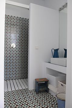 by MariaLladó Love this tile!  also the slat floor in the shower is nice too. Handmade tiles can be colour coordinated and customized re. shape, texture, pattern, etc. by ceramic design studios